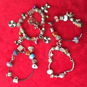 4 charmed bracelets, with tons of charms